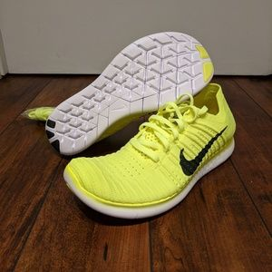 sports shoes 8a777 7ea6d Nike Shoes - Nike Air Flyknit Free Run Gold Medal neon volt